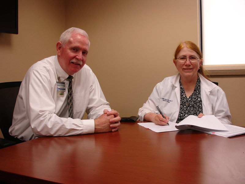 Linda Milholen, MD, general surgeon, has signed a three-year employment contract at TCMH.  Milholhen is shown here with Wes Murray, TCMH chief executive officer.