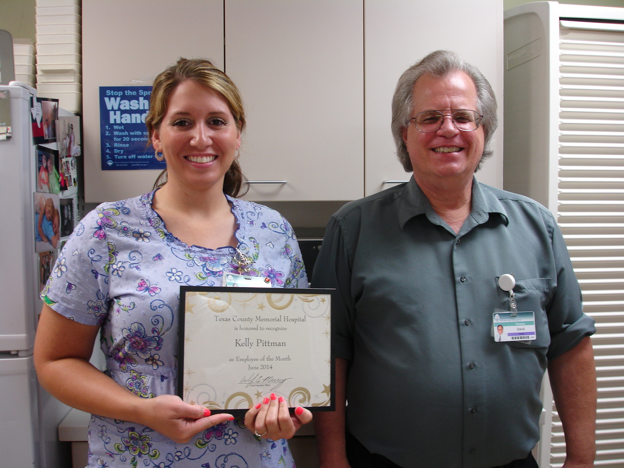 Kelly Pittman, Texas County Memorial Hospital June employee of the month, with her supervisor, David Phipps.