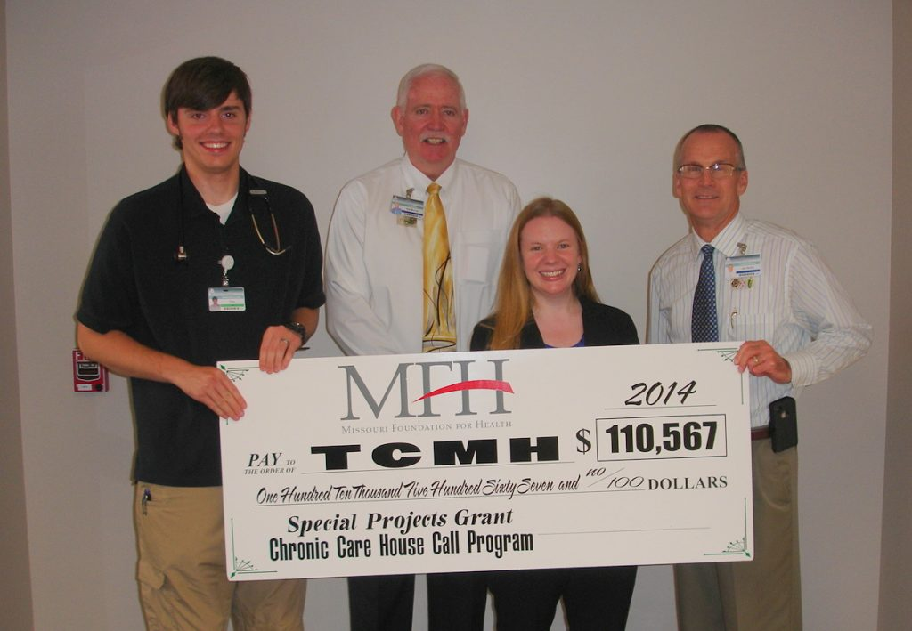 Jean Freeman-Crawford, program officer for the Missouri Foundation for Health, presented a ceremonial check to Texas County Memorial Hospital for the house call grant for chronically ill patients.  Shown with the check are (left to right) Chip Lange, physician assistant at TCMH; Wes Murray, TCMH CEO; Freeman-Crawford, and Jay Gentry, TCMH Healthcare Foundation director.
