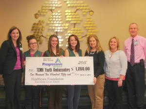 Progressive Ozark Banks in Houston and Mountain Grove partnered together to make a $1250 donation to the TCMH Healthcare Foundation Youth Ambassador Scholarship Fund.  Shown here during the donation presentation are (left to right) April Steele, TCMH Youth Ambassador program coordinator; Youth Ambassadors Claireesa Ridenhour of Licking, Melody Tate of Houston, Jessica Wensel of Plato; Earleen Holder, Progressive Ozark Bank Houston market manager; Danetta Rodgers, Progressive Ozark Bank Mountain Grove lending officer, and Jay Gentry, Healthcare Foundation director.