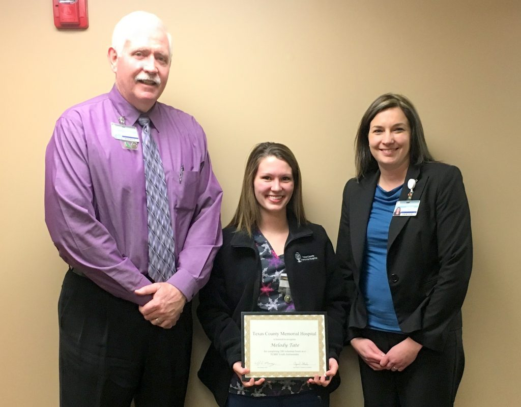 Melody Tate (center) received special recognition from Texas County Memorial Hospital for volunteering over 500 hours at the hospital over the past year and half.  Shown here with Tate are Wes Murray, TCMH CEO (left), and April Steele, TCMH Youth Ambassador program coordinator.
