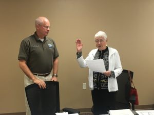 Texas County Memorial Hospital board of trustees chairperson, Dr. Jim Perry, OD (left), administered the oath of office to Omanez Fockler, returning board member at the meeting on Tuesday.