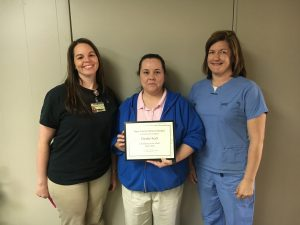 Christie Koch (center), Texas County Memorial Hospital March employee of the month, with Ellen Willis, physical therapy department director (far left) and Krista Elliott, Home Health of the Ozarks director.