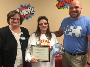 Modena Jones (center) Texas County Memorial Hospital CNA of the year, with Doretta Todd-Willis (left), TCMH chief nursing officer, and John Sawyer, medical surgical department manager.