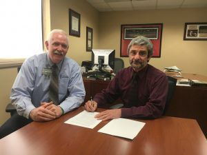 Juan Mella, MD (right), a board certified pulmonologist, has signed a contract to work part-time for Texas County Memorial Hospital at the TCMH Medical Complex in Houston beginning in mid-June.  Mella is shown here with Wes Murray, TCMH chief executive officer.
