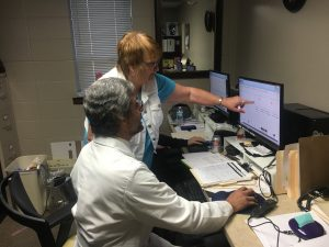 Dr. Juan Mella, pulmonologist at Texas County Memorial Hospital, discusses results from a sleep study with Paula McDaniel, certified sleep therapist at the TCMH Sleep Studies Laboratory.