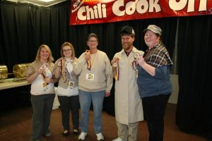 """Deductive Seasoning"", the Sherlock Holmes-themed team sponsored by the Houston Walmart Supercenter won the top prize of the cook off for raising the most funds for Hospice of Care--$6938.98."