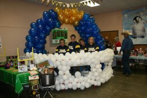 """""""Team Jayson"""" sponsored by Peoples Community Bank in Cabool cooked and served chili out of a giant balloon helmet. They won third place for team fundraising at the event."""