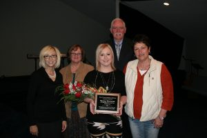 Brooke Whitaker, a registered nurse in the Texas County Memorial Hospital emergency department, received the Employee of the Year honor at TCMH for 2016.  Shown here are Linda Pamperien, chief financial officer, Doretta Todd-Willis chief nursing officer, Whitaker, Wes Murray, chief executive officer, and Jerri Sue Crump, emergency department nurse manager.